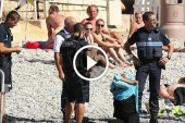 شاهد كيف اجبرت الشرطة الفرنسية إمرأة مسلمة على خلع ملابسها بشاطئ في 'نيس'