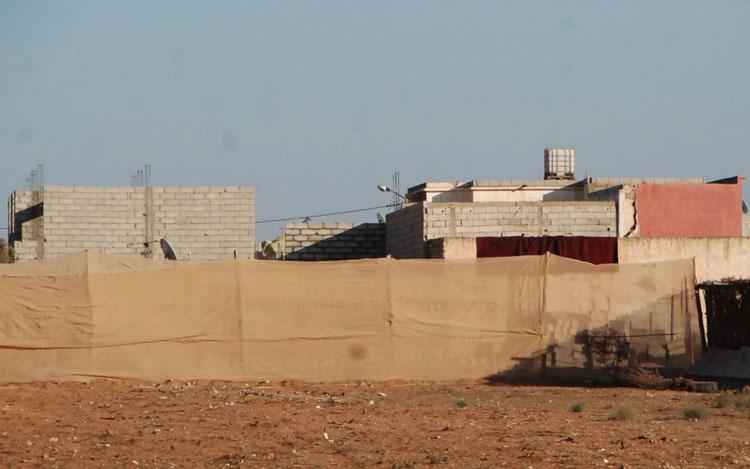 البنايات العشوائية بجماعة سيدي بيبي استفادت من الماء والكهرباء دون رخصة البناء