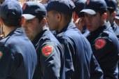 رجال الأمن يرتدون بدلات جديدة