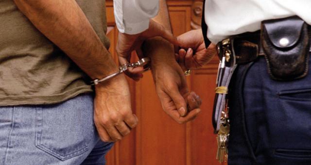 أمن جرادة يوقف احد المبحوث عنهم بتهمة القتل العمد