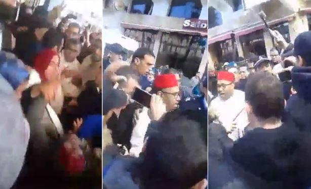 """عاملات مطرودات يحاصرن عمدة مكناس ويتهمنه بـ""""الكذب"""" والشرطة تتدخل لإنقاذه"""