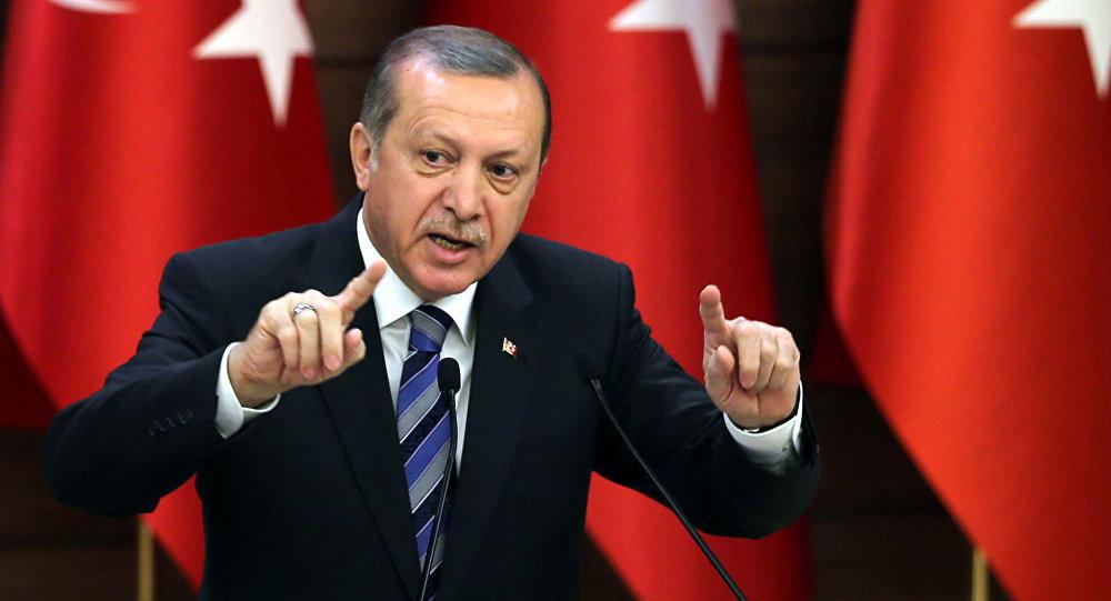 صورة أردوغان يقيل أكثر من 18 ألف موظف تركي